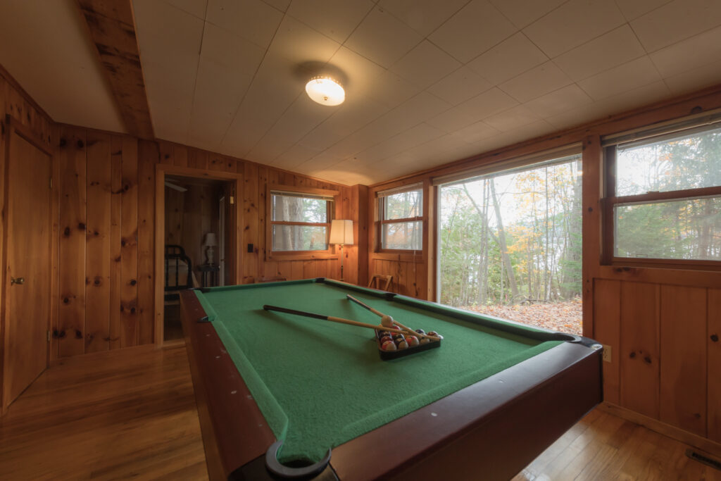 The pool room with view toward the lake